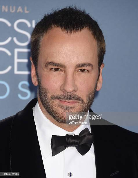 Fashion designerproducerdirector Tom Ford arrives at The 22nd Annual Critics' Choice Awards at Barker Hangar on December 11 2016 in Santa Monica...