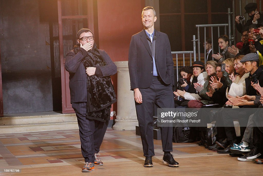Fashion designers <a gi-track='captionPersonalityLinkClicked' href=/galleries/search?phrase=Alber+Elbaz&family=editorial&specificpeople=783481 ng-click='$event.stopPropagation()'>Alber Elbaz</a> (L) and Lucas Ossendrijver acknowledge applause following the Lanvin Men Autumn / Winter 2013 show at Ecole Nationale Superieure Des Beaux-Arts as part of Paris Fashion Week on January 20, 2013 in Paris, France.