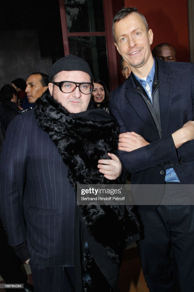 Fashion designers <a gi-track='captionPersonalityLinkClicked' href=/galleries/search?phrase=Alber+Elbaz&family=editorial&specificpeople=783481 ng-click='$event.stopPropagation()'>Alber Elbaz</a> (L) and Lucas Ossendrijver pose following the Lanvin Men Autumn / Winter 2013 show at Ecole Nationale Superieure Des Beaux-Arts as part of Paris Fashion Week on January 20, 2013 in Paris, France.