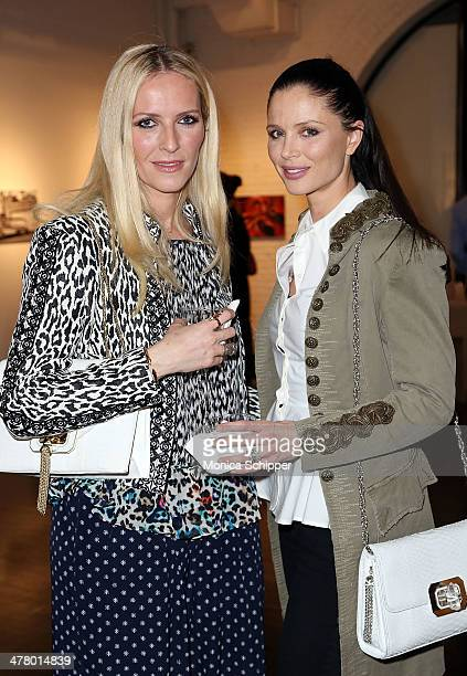 Fashion designers and cofounders of Marchesa Keren Craig and Georgina Chapman attend 'Vs/Better' Charity Art Exhibition opening reception at Dillon...