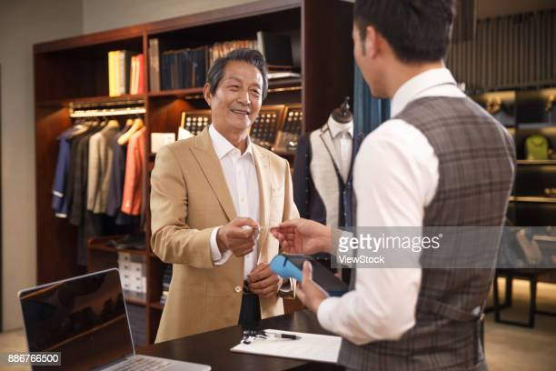 Fashion designers and customers at the checkout counter