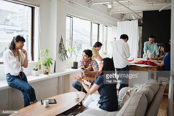 Fashion designers casual meeting in studio