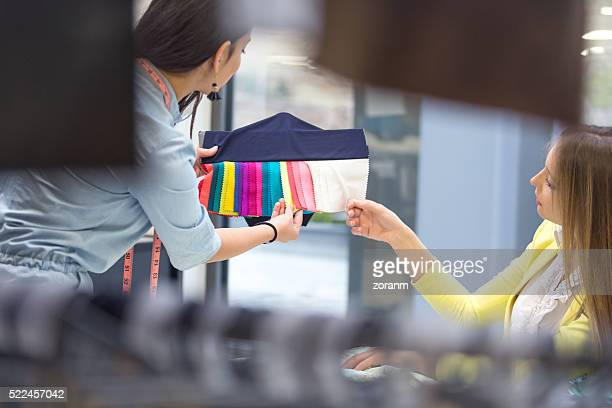 Fashion designers choosing swatches for new models