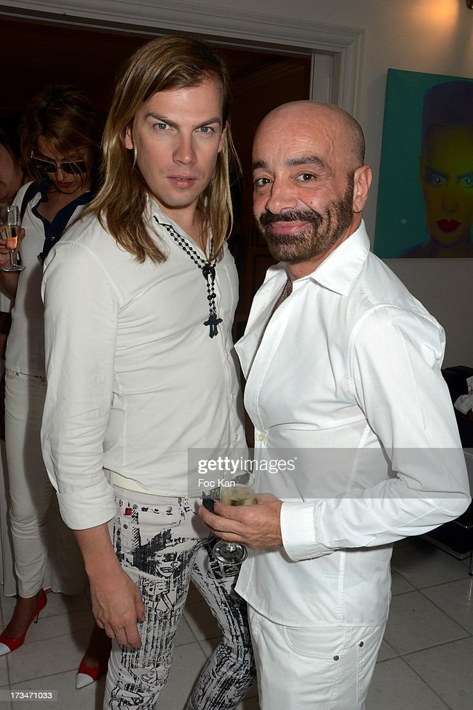 Fashion designers Christophe Guillarme and Simon Azoulay attend the 14th July White Party at the Pierre Guillermo residence on July 14, 2013 in Paris, France.