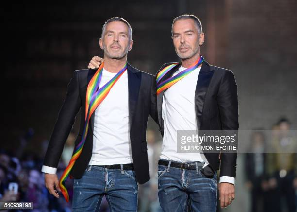 Fashion designers Dan Caten and Dean Caten greet the audience at the end of the show for fashion house Dsquared2 during the Men's Spring Summer 2017...