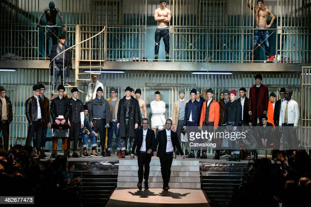 Fashion Designers Dean and Dan Caten walk the runway at the DSquared2 Autumn Winter 2014 fashion show during Milan Menswear Fashion Week on January...