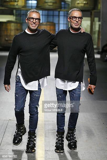 Fashion designers Dean and Dan Caten walk the runway at the Dsquared2 show during Milan Men's Fashion Week Fall/Winter 2017/18 on January 15 2017 in...