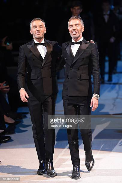 Fashion designers Dean Caten and Dan Caten acknowledge the applause of the audience after the the Dsquared2 Show as a part of Milan Menswear Fashion...