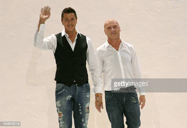 Fashion designers Domenico Dolce and Stefano Gabbana acknowledge the audience at the end of Dolce Gabbana springsummer 2011 readytowear collection on...