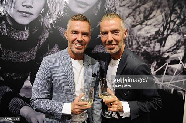 Fashion designers founders and owners of Dsquared2 Dan Caten and Dean Caten pose for a photo inside Dsquared2 stand at 81 Pitti Bimbo on June 25 2015...