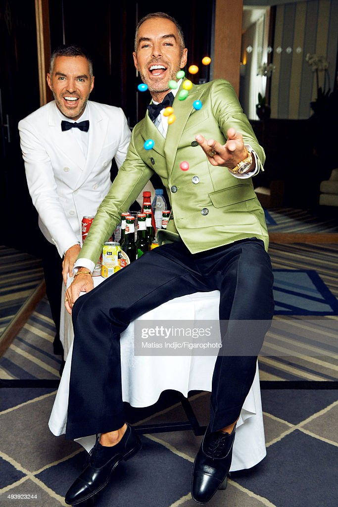 Fashion designers, founders and owners of DSquared2, Dean Caten and Dan Caten are photographed for Madame Figaro on May 23, 2015 in Cannes, France. All (DSquared2), personal jewelry, watch (Rolex). PUBLISHED IMAGE.