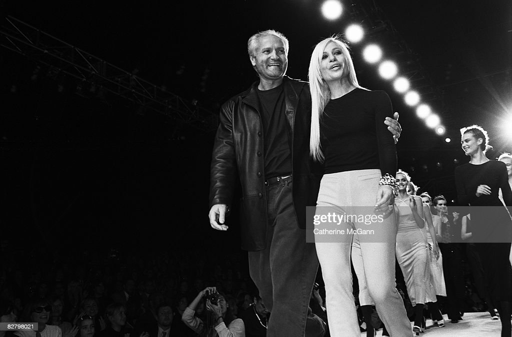 Fashion designers Gianni Versace (1946 -1997) and Donatella Versace on the runway after a Versace fashion show in March 1996 in New York City, New York.