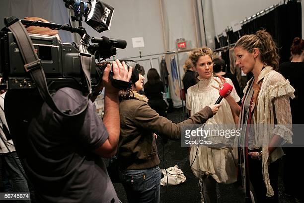 Fashion designers Heidi Middleton and partner SarahJane Clarke of Sass Bide give an interview backstage at the Sass Bide Fall 2006 fashion show at...