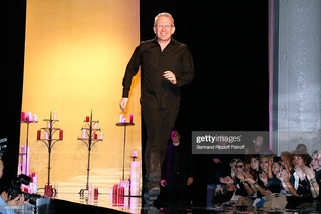 Fashion designers Jean-Paul Gaultier runs the runway at the end of the Jean Paul Gaultier show as part of Paris Fashion Week - Haute Couture Fall/Winter 2014-2015. Held at 325 Rue Saint Martin on July 9, 2014 in Paris, France.