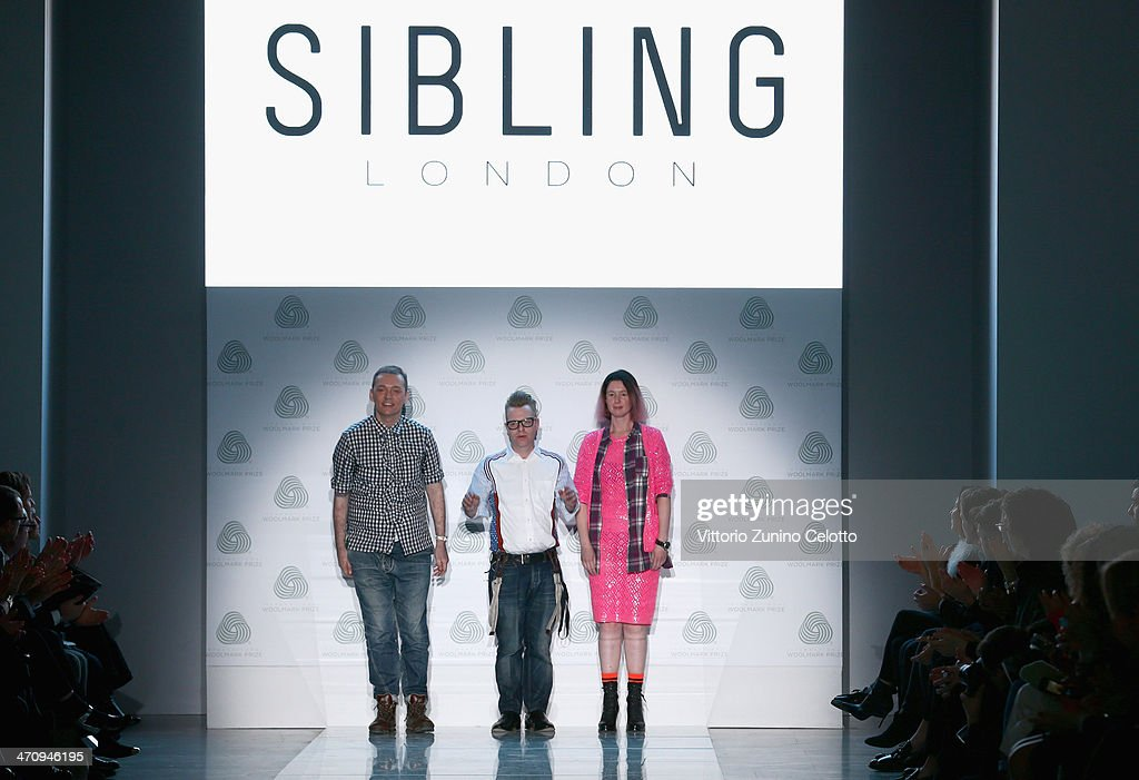 Fashion designers Joe Bates, Sid Bryan and Cozette McCreery on the runway after their Sibling show during the International Woolmark Prize as part of Milan Fashion Week Womenswear Autumn/Winter 2014 on February 21, 2014 in Milan, Italy.