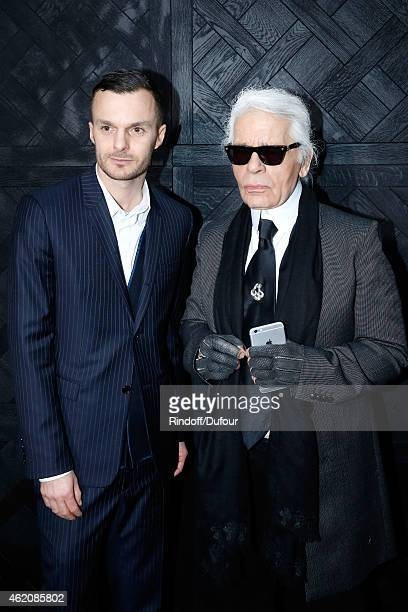 Fashion designers Kris Van Assche and Karl lagerfeld pose backstage after the Dior Homme Menswear Fall/Winter 20152016 Show as part of Paris Fashion...