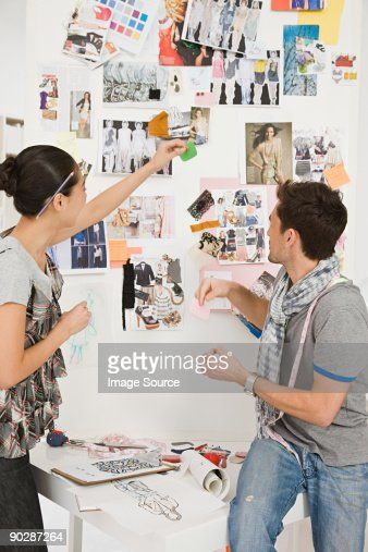 Fashion designers looking at sketches