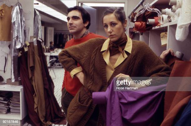 Fashion designers Louis Dell'Olio and Donna Karan stand together in the Anne Klein workroom located in New York city's garment district 1980