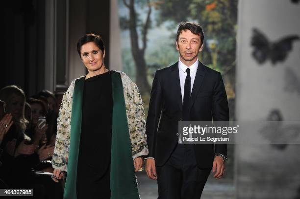 Fashion designers Maria Grazia Chiuri and Pier Paolo Piccioli acknowledge the applause of the audience at the end of the Valentino show as part of...