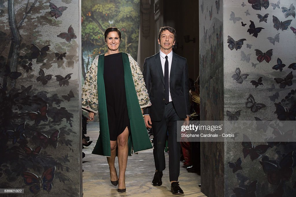 Fashion designers Maria Grazia Chiuri and Pier Paolo Piccioli acknowledge the applause of the audience at the end of the Valentino show as part of Paris Fashion Week Haute Couture Spring/Summer 2014, in Paris.