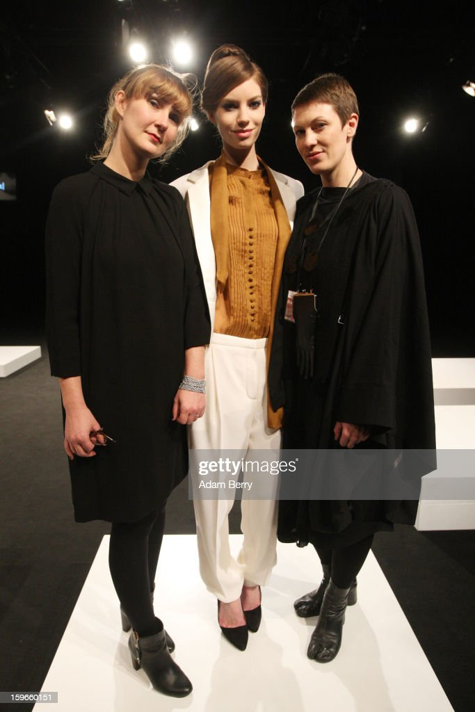Fashion designers Nadine Moellenkamp (L), Silke Geib (R) and a model pose on stage at Blaenk Autumn/Winter 2013/14 fashion show during Mercedes-Benz Fashion Week Berlin at Brandenburg Gate on January 18, 2013 in Berlin, Germany.