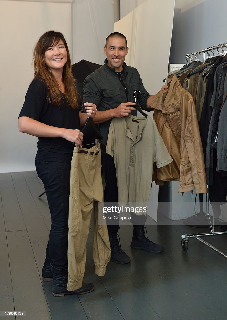LOOK #14. Fashion designers Nicholas Kunz (L) and Christopher Kunz choose pieces from their collection on August 30, 2013 in New York City.