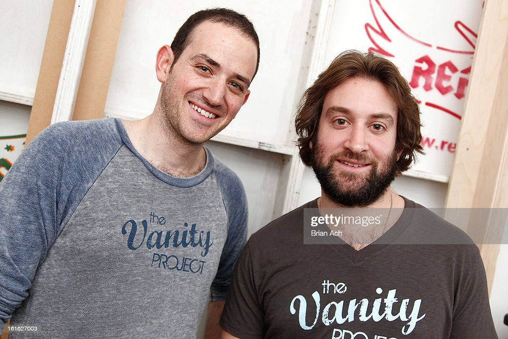 Fashion designers Omri Bojko (L) and Jason Sochol pose backstage at Nolcha Fashion Week New York 2013 presented by RUSK at Pier 59 Studios on February 13, 2013 in New York City.