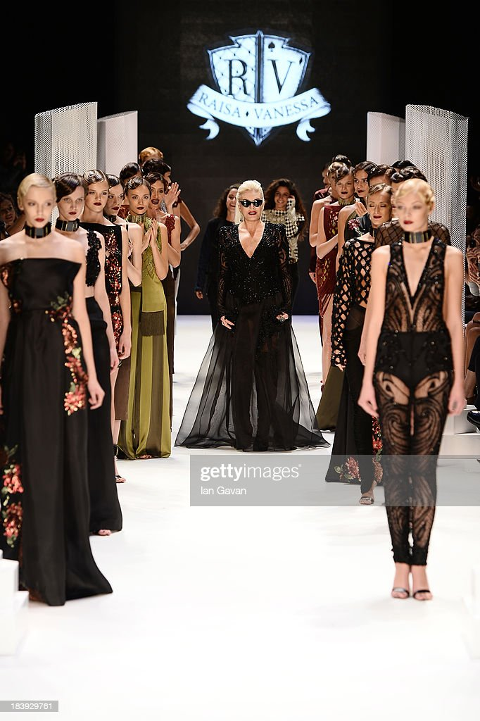 Fashion designers Raisa Sason (L), Vanessa Sason (R) and actress Ajda Pekkan walk the runway at the Raisa-Vanessa Sason show during Mercedes-Benz Fashion Week Istanbul s/s 2014 Presented By American Express on October 10, 2013 in Istanbul, Turkey.