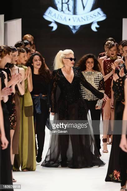 Fashion designers Raisa Sason Vanessa Sason and actress Ajda Pekkan walk the runway at the RaisaVanessa Sason show during MercedesBenz Fashion Week...