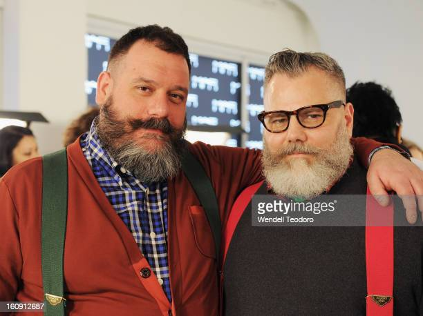 Fashion Designers Robert Tagliapietra and Jeffrey Costello pose backstage before the Costello Tagliapietra show during Fall 2013 MADE Fashion Week at...