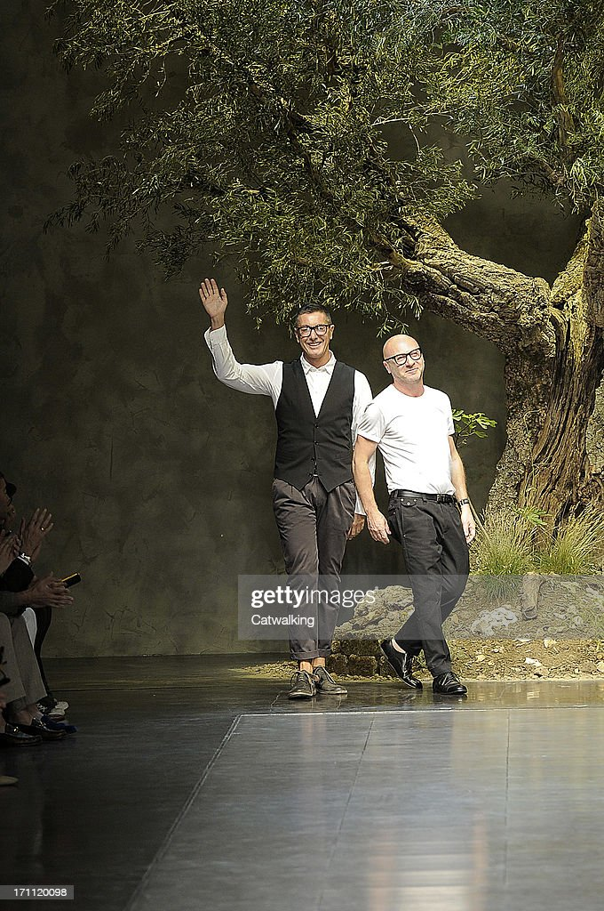 Fashion designers Stefano Gabbana (L) and Domenico Dolce (R) walk the runway at the Dolce & Gabbana Spring Summer 2014 fashion show during Milan Menswear Fashion Week on June 22, 2013 in Milan, Italy.