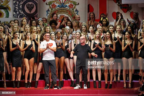 Fashion designers Stefano Gabbana and Domenico Dolce walk the runway at the Dolce Gabbana Ready to Wear Spring/Summer 2018 fashion show during Milan...