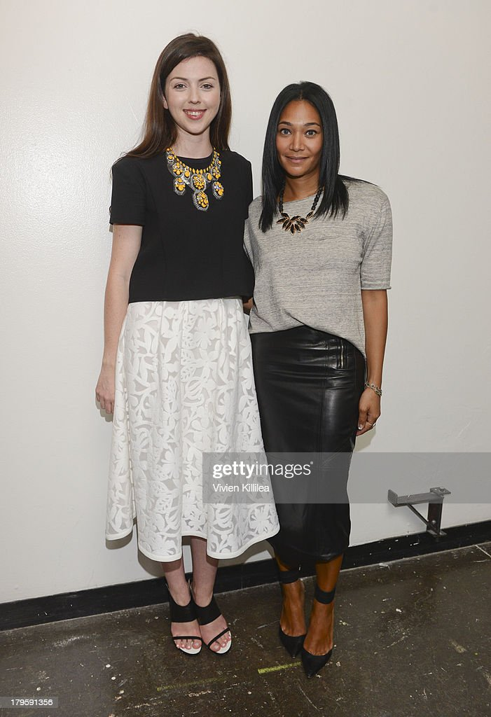 Fashion designers Tanya Taylor and Monique Pean backstage at the Tanya Taylor fashion show during Mercedes-Benz Fashion Week Spring 2014 at Industria Studios on September 5, 2013 in New York City.
