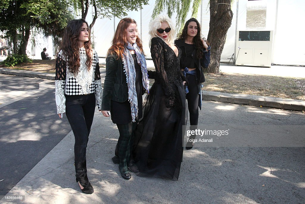 Fashion designers Vanessa Sason (L), Raisa Sason (R) and actress Ajda Pekkan (2nd R) attend Mercedes-Benz Fashion Week Istanbul s/s 2014 presented by American Express on October 10, 2013 in Istanbul, Turkey.