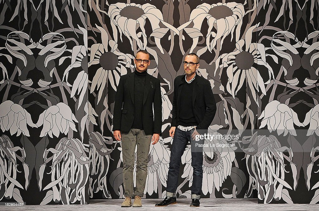 Fashion designers Viktor Horsting (L) and Rolf Snoeren acknowledge applause following the Viktor&Rolf Fall/Winter 2013 Ready-to-Wear show as part of Paris Fashion Week on March 2, 2013 in Paris, France.