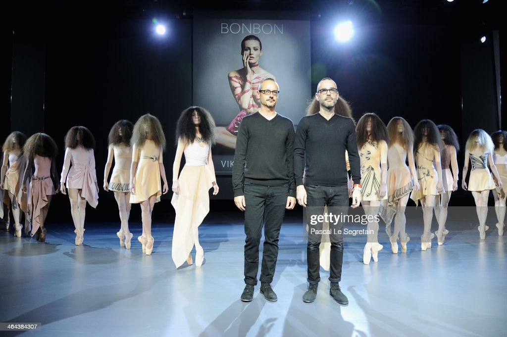 Fashion designers Viktor Horsting and Rolf Snoeren acknowledge the applause of the audience after the Viktor&Rolf show as part of Paris Fashion Week Haute Couture Spring/Summer 2014 on January 22, 2014 in Paris, France.