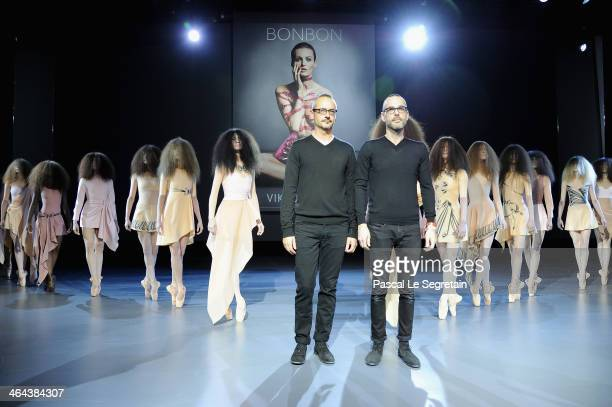 Fashion designers Viktor Horsting and Rolf Snoeren acknowledge the applause of the audience after the ViktorRolf show as part of Paris Fashion Week...
