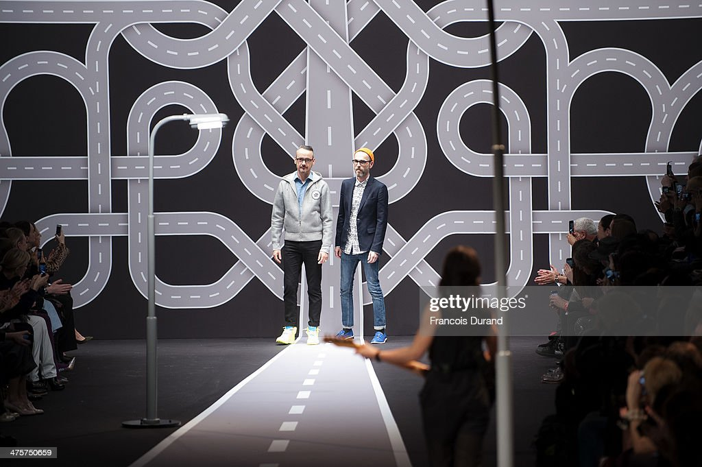Fashion designers Viktor Horsting and Rolf Snoeren appear at the end of the runway during the Viktor&Rolf show as part of the Paris Fashion Week Womenswear Fall/Winter 2014-2015 on March 1, 2014 in Paris, France.