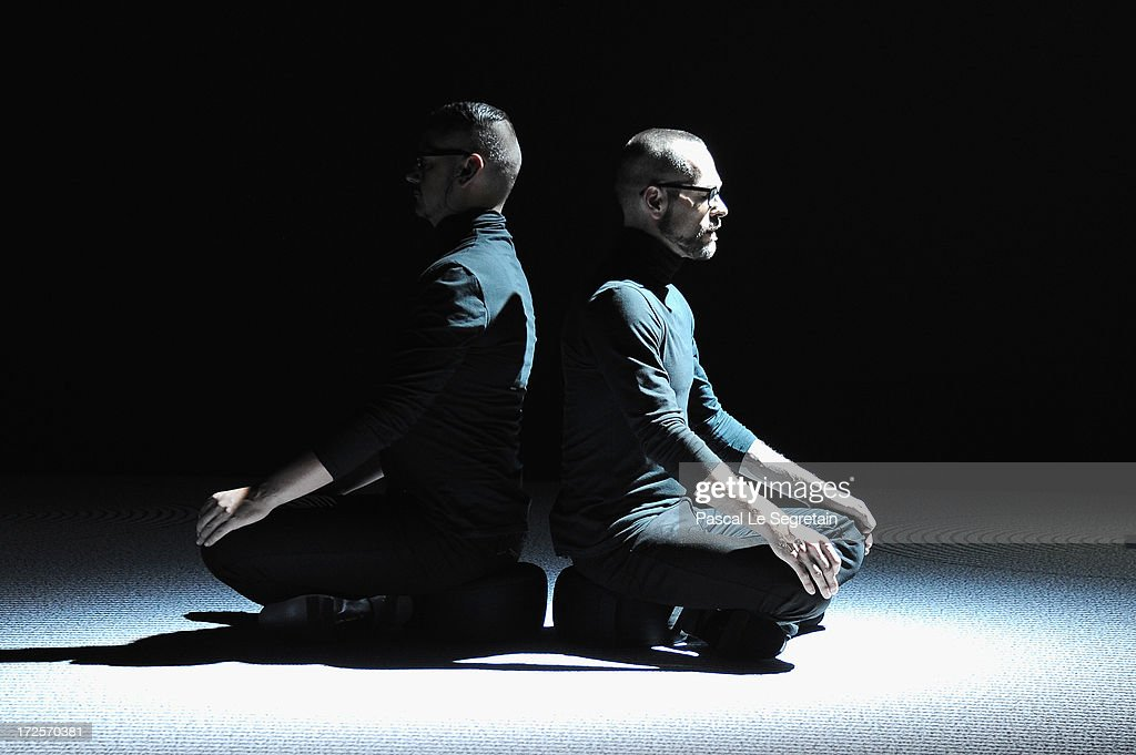 Fashion designers Viktor Horsting and Rolf Snoeren perform during the Viktor&Rolf show as part of Paris Fashion Week Haute-Couture Fall/Winter 2013-2014 at La Gaite Lyrique on July 3, 2013 in Paris, France.