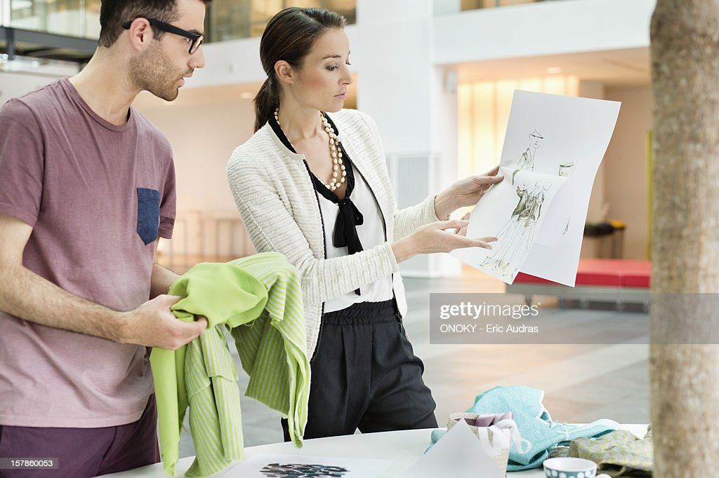 Fashion designers working in an office : Stock Photo
