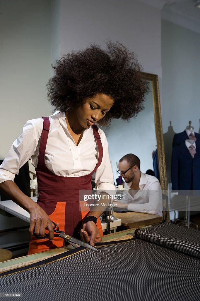 Fashion designers working in fashion studio : Stock Photo