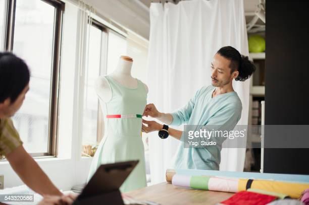 Fashion designers working in studio