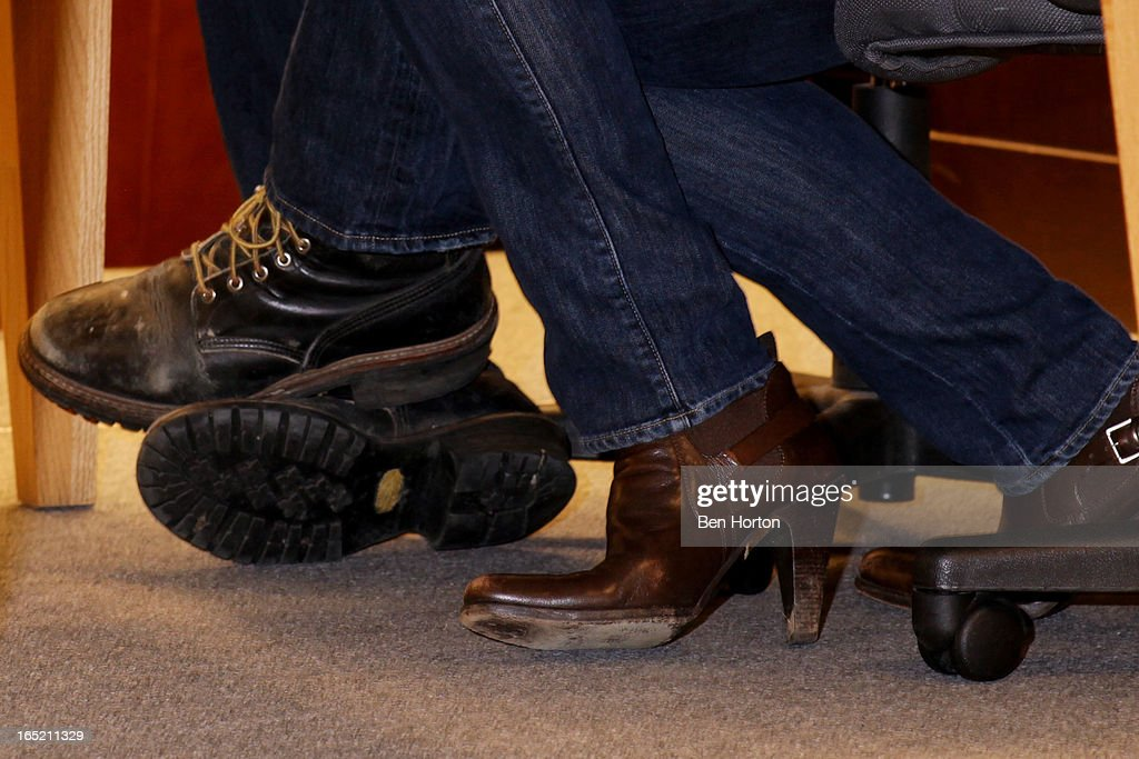 A fashion detail of Bobby Williams and Mariel Hemingway's shoes while they sign copies of their book 'The Willing Way' at Barnes & Noble bookstore at The Grove on April 1, 2013 in Los Angeles, California.