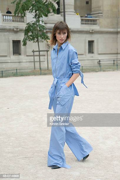 Fashion Director and Stylist for Tatler Russia Anya Ziourova wears a Rosie Assoulin jumpsuit a Dior necklace and Pierre Hardy shoes on day 3 of Paris...