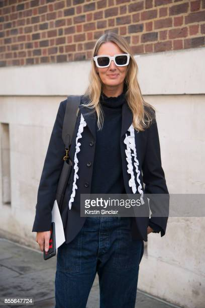 Fashion director at Grazia Uk Rebecca Lowthorpe wears a Comee Des Garcons jacket Margeret Howell for Edwin jeans Celine sunglasses on day 2 of London...