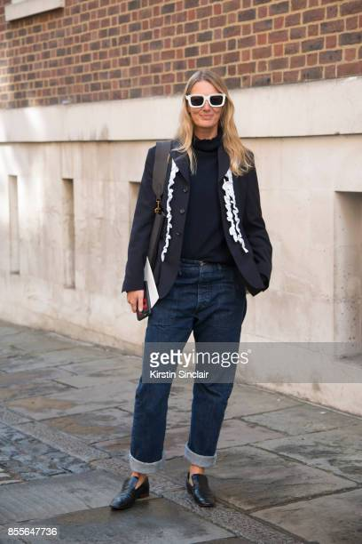 Fashion director at Grazia Uk Rebecca Lowthorpe wears a Comee Des Garcons jacket Margeret Howell for Edwin jeans Celine shoes bag and sunglasses on...