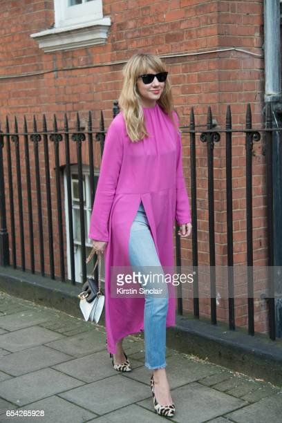 Fashion Director at Net a Porter Lisa Aiken wears a Balenciaga dress JW Anderson bag Re/Done jeans Ray Ban sunglasses and Jimmy Choo shoes on day 2...