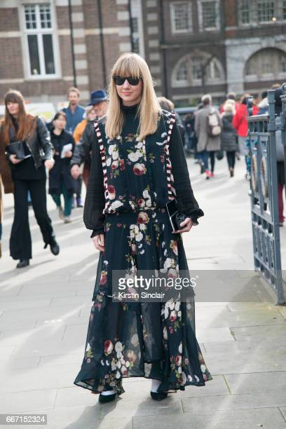Fashion Director at Net a Porter Lisa Aiken wears a Preen dress and Ray Ban sunglasses on day 4 of London Womens Fashion Week Autumn/Winter 2017 on...