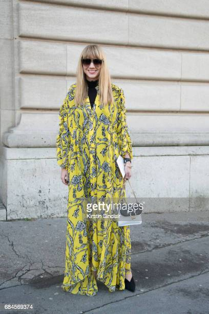 Fashion Director at Net a Porter Lisa Aiken wears an Ellery dress JW Anderson bag Prada shoes on day 3 during Paris Fashion Week Autumn/Winter...