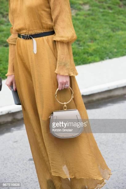 Fashion director at NetAPorter Lisa Aiken wears a Beaufille dress and a Chloe bag day 3 of Paris Womens Fashion Week Spring/Summer 2018 on September...